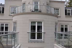 Silver balustrading and Juliet balcony on large beautiful white house