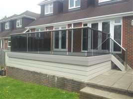 Balustrade with Royal Chrome handrails and posts and tinted glass