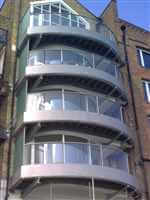 Curved silver balcony 1 balustrade overlooking the Thames