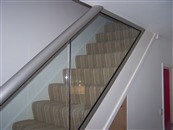 Glass Balustrades on stairs runs and staircases. Balcony systems introduces a 72mm X 72mm Newel Post that allows glass balustrades and railings to be used on stair runs easily.