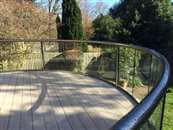 Enhancing buildings and homes through the use of curved glass and curved elements.