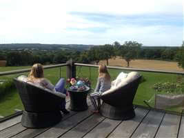 Girls sitting on the balcony in Sussex