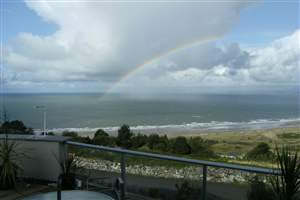Coast house with Royal Chrome balustrade with a view of a rainbow