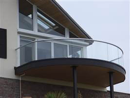 Semi frameless balcony with silver handrails