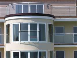 Silver balustrading and Juliet balconies on seafront residences