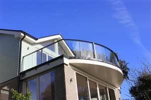 Curved balustrade with Royal Chrome handrails and blue sky