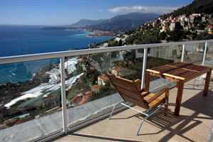 White balustrade looking down on the beautiful mountains and coast