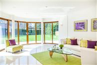 Curved Glass Sliding Doors and matching RAL colour Glass Juliet add WOW factor to stunning, modern Sussex home