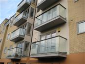 Contemporary Glass Juliette Balconies and Glass Balustrades with Aluminium handrails match modern new build of apartments in Hemel Hempstead.