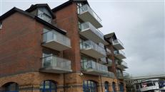 Glass Balustrades by Balcony Systems transform London riverside apartment block. Innovative and quality glass balcony replaced the original steel railings bolted to the concrete slab balconies.