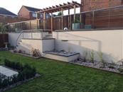 Glass Balcony Review.  Balcony 1 system glass balustrade. Very impressed with the quality and overall look of the installed glass balustrade. Really enhances the garden from all aspects.