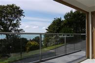 A Review on Glass Balustrade in Sandgate. The balusrade combines the best balance of maximum visibility through glass and a pleasing, strong supporting structure. The anodised royal chrome design is very pleasing to the eye.