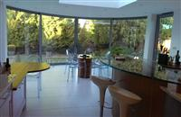 Beautiful curved glass sliding doors at a house in Epping Forest