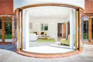 Large open Curved Glass Sliding Doors Sussex