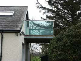Tinted glass and silver handrail balcony