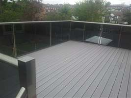Royal Chrome balustrade with tinted glass and Composite Decking