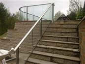 Glass Balustrade for stair runs, staircases and for raked runs.  What solutions are possible?