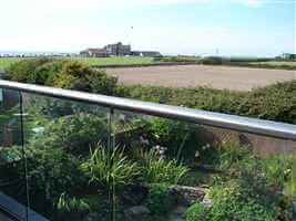 Coast house with Royal Chrome balustrade with views of pretty garden, fields and the sea