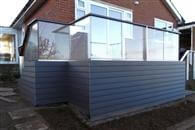 Glass Balustrade Review. Balcony 2 system glass balustrade in North Yorkshire. The balcony system is what our house is all about, it looks fantastic, we get compliments all the time from passers by and guests alike.