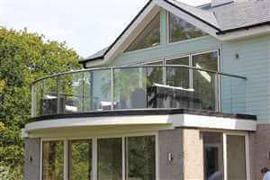 Royal Chrome curved balustrade on a pretty house with lovely gardens