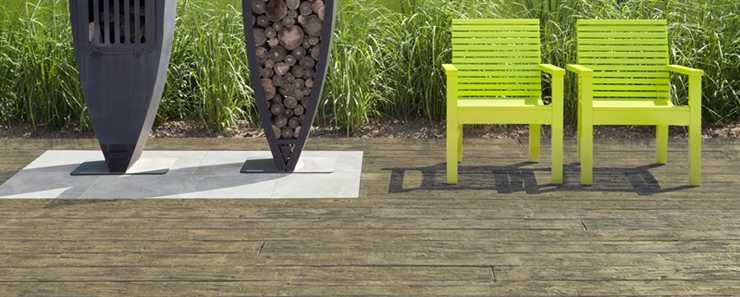 Weathered Composite Decking with chairs and logs