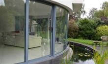 Looking for a way to make a real impact with your project? Then install Balconette's curved glass sliding doors. Breathtakingly beautiful, they do more than just keep out the cold and let you enjoy the view.