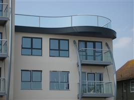 Curved and straight Royal Chrome balconies on the coast