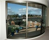 Maximising light and satisfying strict aesthetic requirements, Balcony Systems met the architect's specification for Curved Glass Patio Doors and Glass Balustrading.