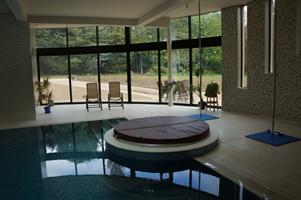 curved patio doors and fixed lights in pool area