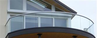 Various balcony systems are explored and explained. This article is written for anyone considering installing a balcony system, particularly one with glass.