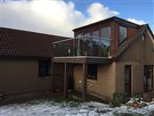 From wooden slats to glass, a clear glass post-less balcony supplied by Balconette has opened up extensive views to the surrounding coastal areas and sea from this property near Aberdeen in North East Scotland.