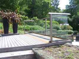 Balustrade and decking in the sun with silver aerofoil balcony