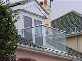 Loft conversion balcony with silver handrail