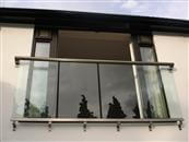 Why is balustrading in glass being seen so frequently in new building projects? What's the different between a Juliet balcony in glass and a glass balustrade?