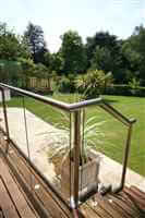 Royal Chrome balustrade on balcony and stairs to pretty garden