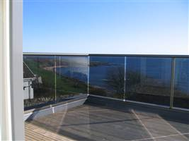 Bronze Balcony 2 with tinted glass by the coast