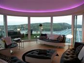 Fantastic panoramic views of the Isle of Man from a luxurious bed and breakfast property with Balcony's low-maintenance clear glass balustrading and curved sliding patio doors.