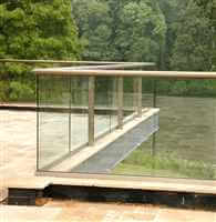 Zigzag bronze handrail balustrade with clear glass and bronze handrail