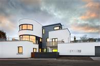 Stunning curved sliding patio doors and windows take advantage of panoramic sea views at Art Deco seafront house at East Lothian on the north-east Scottish coast.