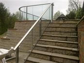 Glass stair railing - a run of glass with a handrail on top, alongside a flight of indoor or outdoor stairs. It is a glass balustrade for stairs and we have been specializing in stair glazed balustrading systems.