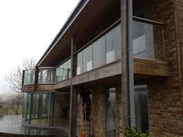 Curved doors and curved balustrade with silver handrails and posts