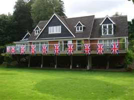 Royal Chrome balustrade across the back of a house with Union Jack flags