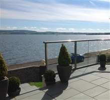 Royal Chrome Glass Balcony overlooking lake in Scotland