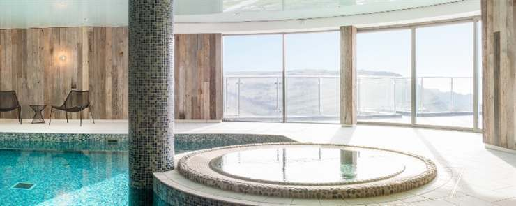 Curved Sliding Doors showing an amazing view from the pool