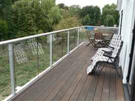 Silver balustrade with sun loungers on the decking