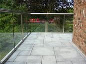 39 metre curved and straight self-cleaning glass balustrading added to canalside home to accentuate views.
