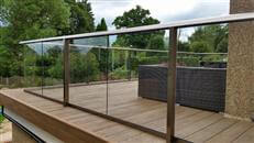 Glass Balcony Balustrade refurbishment and new composite decking in a house in Reigate, Surrey by Balcony Systems. Self cleaning glass balustrades for terrace and stairs.