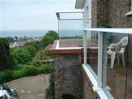 Side on shot of white balustrading showing the scenic view