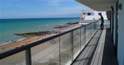 Spacious glass balconies of a new luxury apartment development on the South Coast. Glass Balustrading by Balcony Systems in Rottingdean.