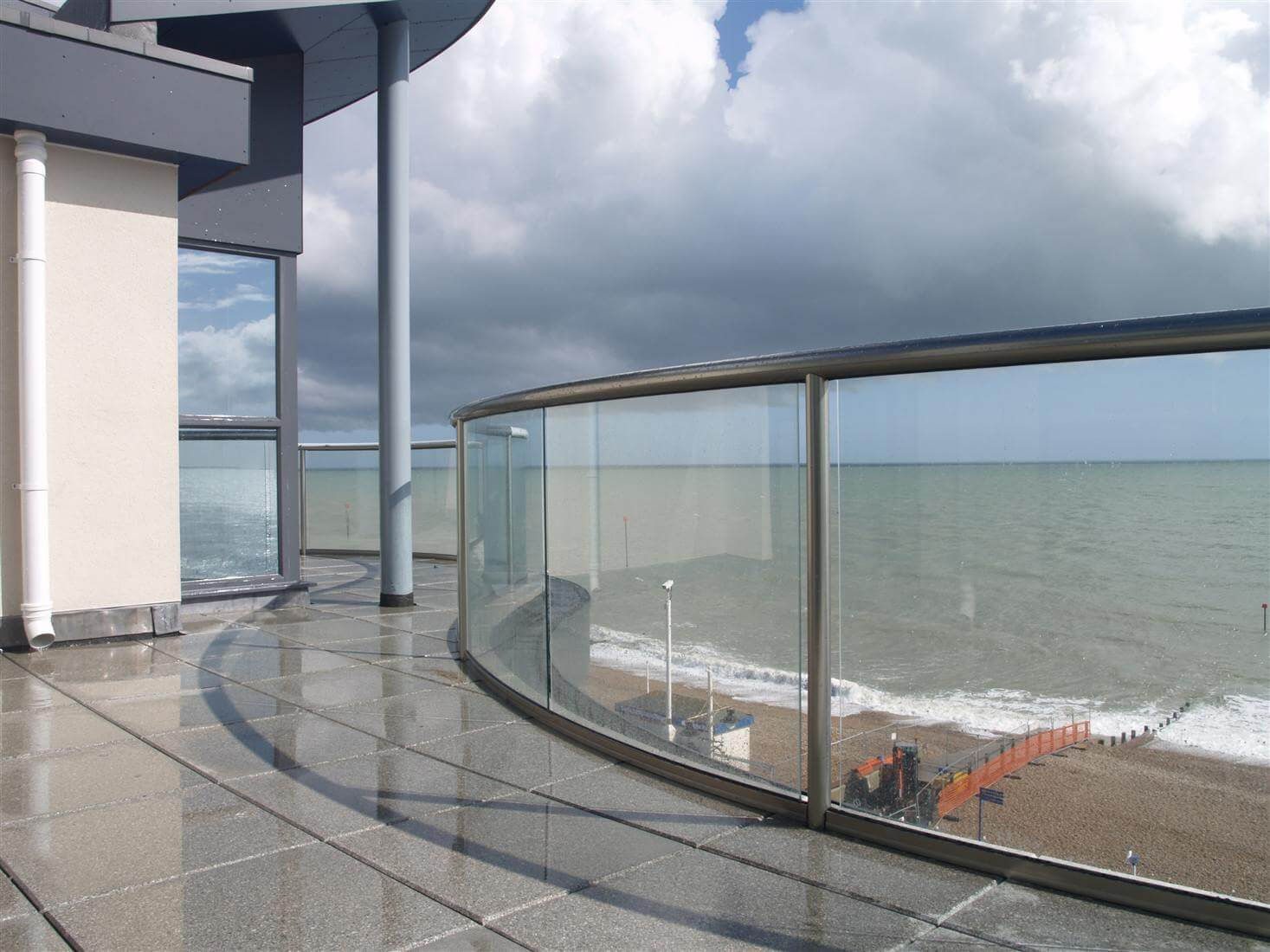 Coastal curved balconies bognor regis sussex project for Balcony with glass